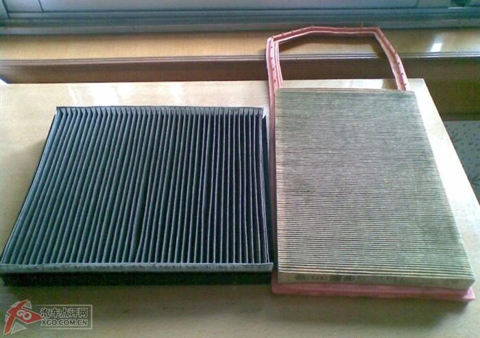 空调滤芯取下了(方便买个一样的回来哈),这里是两个旧的照片  高清图片