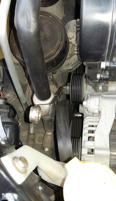 保养09款瑞虎发电机皮带涨紧器张紧器轮子